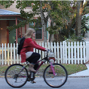 Student on bicycle rides through nearby Lincolnville neighborhood.