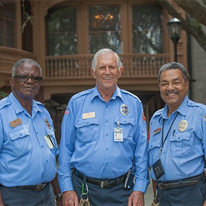 Three security officers.