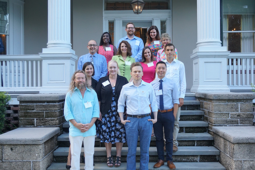 New faculty members for 2017-2018 standing on steps of building.